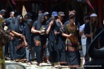 The guest greeters lead the guest to tongkonan at Rambu Solok Ceremony, 2014-Dec